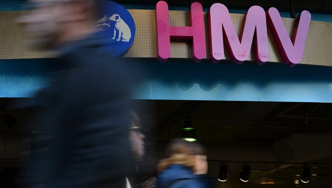 Pedestrians pass a branch of retailer HMV in central London.