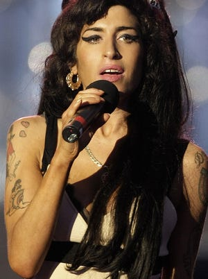 A top Vatican cardinal says he's listened  to the late British singer Amy Winehouse, shown here June 27, 2008, in an effort to learn the concerns of today's youth.