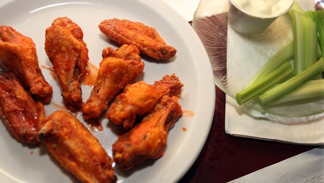 Eating chicken wings on Super Bowl Sunday can pack on calories.