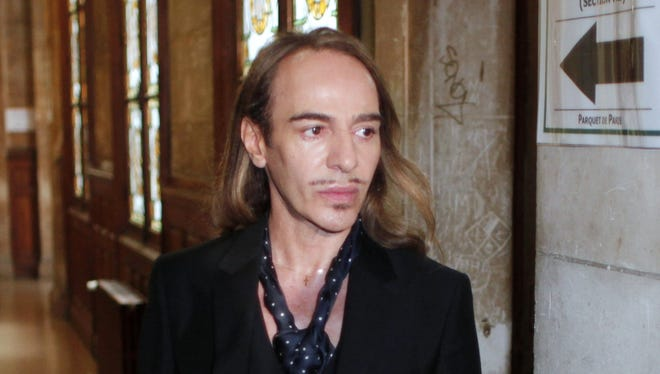 Designer John Galliano arrives at the Paris courthouse on June 22, 2011, charged with hurling anti-Semitic slurs in a Paris cafe. He was found guilty of giving public insults on account of race. His behavior shocked the fashion world and cost him his job at Dior.
