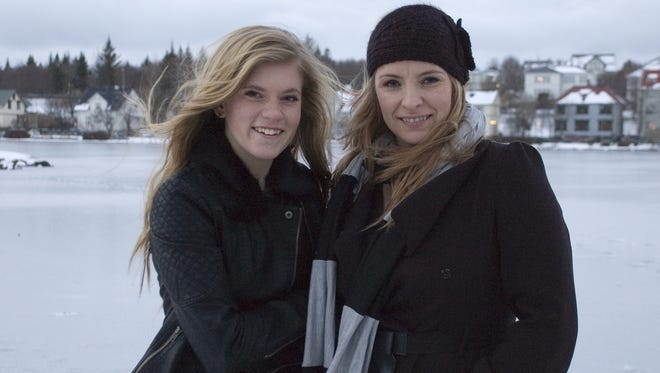 """Blaer Bjarkardottir, left, and her mother, Bjork Eidsdottir, in front of a pond in Reykjavik. The 15-year-old Icelandic girl has been granted the right to legally use the name given to her by her mother, despite the opposition of authorities. A court ruled Thursday that the name """"Blaer"""" can be used. It means """"gentle breeze."""""""