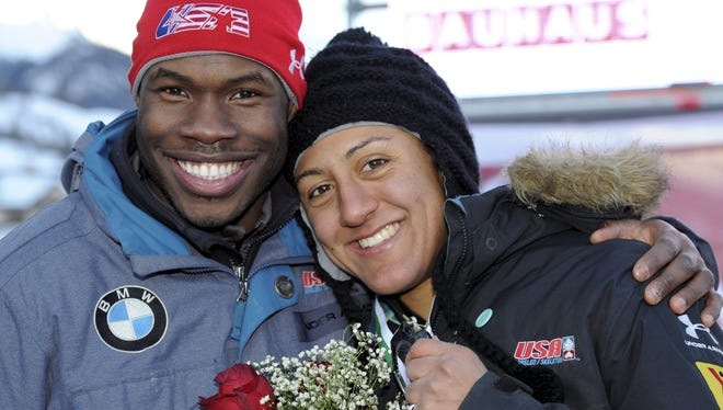Nick Taylor (left), a brakeman of  the U.S. bobsled team, smiles after he proposed to  Elana Meyers during the medal ceremony of the two-woman bobsled world championship competition in St. Moritz, Switzerland,  Jan.  26.