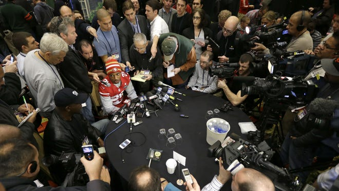 49ers CB Chris Culliver is surrounded by reporters Thursday.