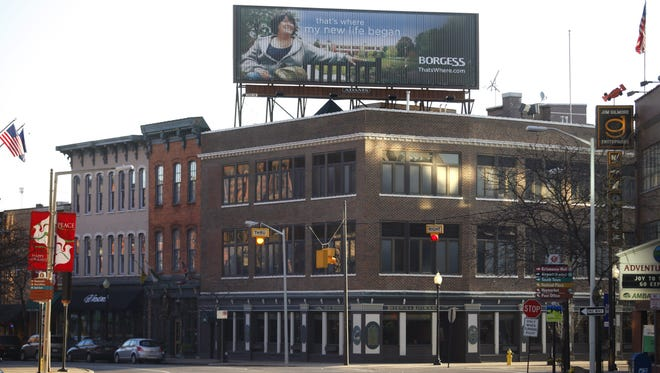 A billboard lights up atop the building housing the Old Peninsula Brew Pub in Kalamazoo, Mich. The city is among those communities seeking to stop the spread of digital billboards.