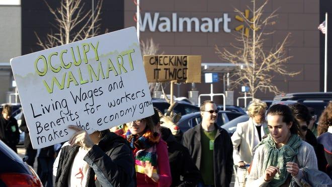 Protesters demonstrate against Wal-Mart on Black Friday, Nov 23, 2012, in Secaucus, N.J.