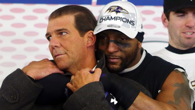 Ray Lewis #52 of the Baltimore Ravens celebrates with owner Steve Bisciotti in the locker room after defeating the New England Patriots in the 2013 AFC Championship game at Gillette Stadium on January 20, 2013 in Foxboro, Massachusetts. The Baltimore Ravens defeated the New England Patriots 28-13.
