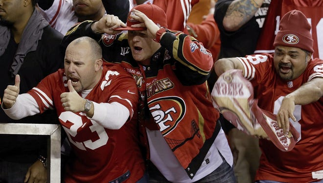 49ers fans celebrate after the NFC Championship game against the Falcons. The 49ers won 28-24 to advance to Super Bowl XLVII.