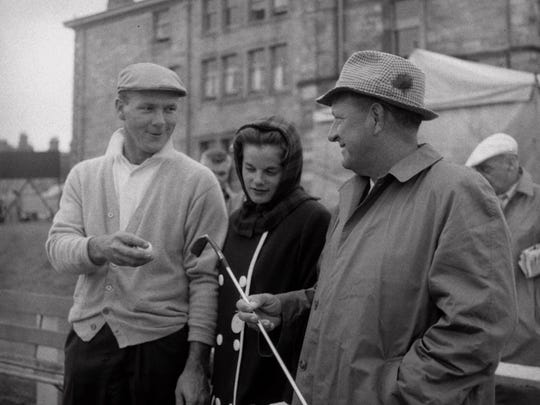 """Arnold Palmer chats with his wife, Winnie, and father, """"Deke,"""" at the 1960 British Open at St. Andrews, Scotland, which he won."""