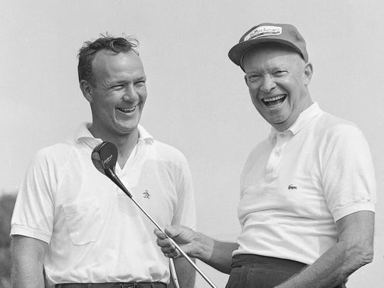 In this Sept. 9, 1960, photo, President Dwight Eisenhower enjoys a laugh with Arnold Palmer before they played a round of golf together in a foursome at the Gettysburg (Pa.) Country Club.