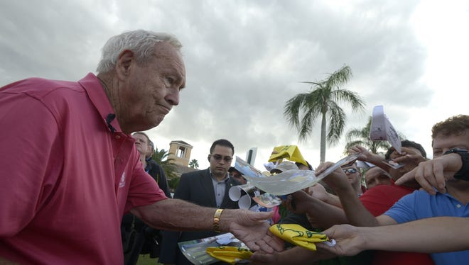 Arnold Palmer continued to be popular with the masses, here signing autographs in December 2012 at the Father/Son Challenge golf tournament in Orlando.