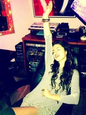 Selena Gomez rocks out in the studio.