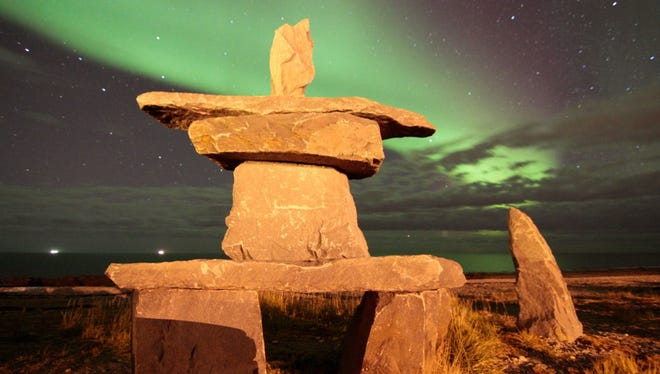 Aurora Borealis sets beacon for Alaska visitors: Northern Lights tourism, where visitors brave long nights, low temperatures and remote locations to view one of nature's more temperamental spectacles, has become big business in the Far North. Here, an inukshuk, a stone landmark built by the Inuit people and other Arctic cultures, is backlit by the lights along a beach in Churchill, Manitoba.