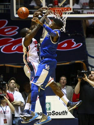 Kentucky's Nerlens Noel, right, denies a dunk attempt Tuesday by Mississippi's Murphy Holloway. That was one of 12 blocks on the night for Noel, a freshman.
