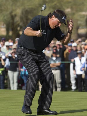 Phil Mickelson just misses a birdie putt on his final hole that would have secured a 59. Even so, Mickelson opened the Waste Management Phoenix Open with an 11-under 60.