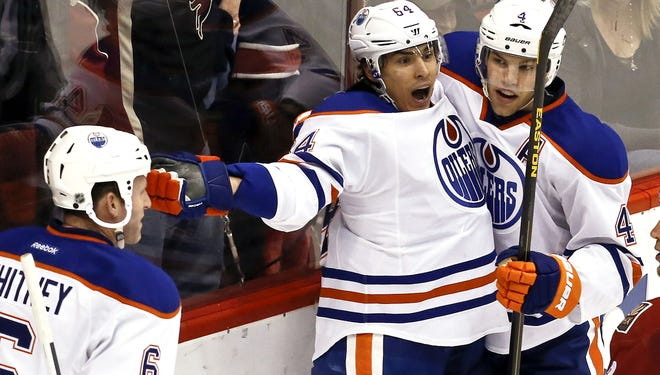 Edmonton Oilers rookie Nail Yakupov (64) has a more subdued celebration this time after scoring in overtime.