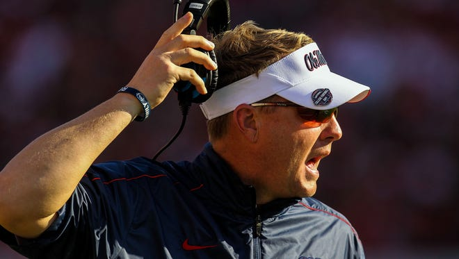Mississippi Rebels head coach Hugh Freeze on the sidelines in the first half against the Georgia Bulldogs at Sanford Stadium.