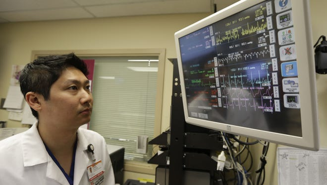 Physician Steve Sun watches a heart monitor display Jan. 14 in the ER at St. Mary's Medical Center in San Francisco. A government report shows the number of people seeking emergency treatment after consuming energy drinks has doubled nationwide over the past four years.