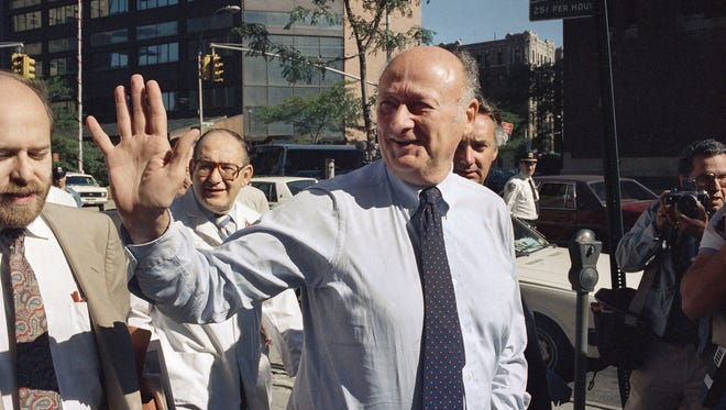 In this 1987 file photo, former New York Mayor Koch waves to onlookers as he arrives at New York's Columbia Presbyterian Hospital Neurological Center. Koch died Friday from congestive heart failure, spokesman George Arzt said. He was 88.