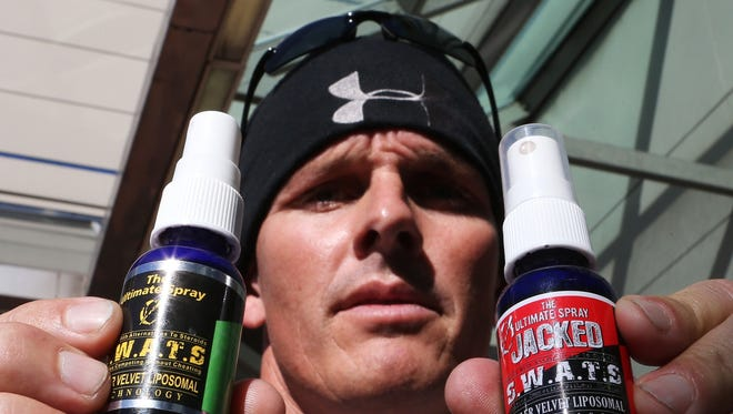 Mitch Ross, co-owner of a company called S.W.A.T.S. (Sports with Alternatives to Steroids) speaks to reporters.