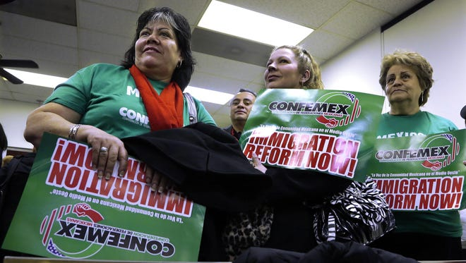 Supporters of granting illegal immigrants drivers licenses rally during a House committee hearing at the Illinois State Capitol Monday, Jan. 7, 2013, in Springfield Ill.