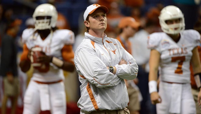 Texas co-offensive coordinator Major Applewhite admitted to having an inappropriate relationship with a student in 2009.