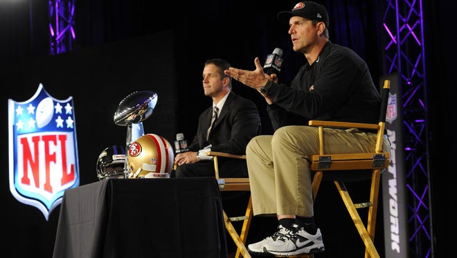 John, left, and Jim Harbaughs answer reporters' questions Friday for the final time before Super Bowl XLVII.