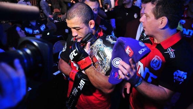 Jose Aldo celebrates his unanimous-decision victory over Frankie Edgar.