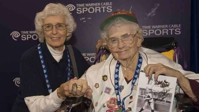 """Shirley """"Hustle"""" Burkovich, left, and Lavonne """"Pepper"""" Paire Davis, from the All American Girls Professional Baseball League, stop by the Time Warner Cable Sports booth at the MLB All-Star FanFest in Anaheim, Calif., on July 11, 2010."""