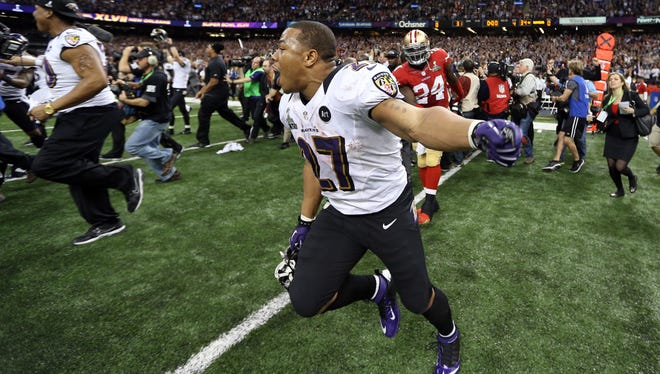 Ravens running back Ray Rice runs off the field after winning Super Bowl XLVII against the 49ers Sunday.