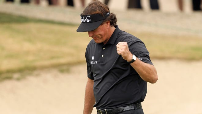 Phil Mickelson makes birdie on No. 4 on his way to victory Sunday in the Waste Management Phoenix Open.