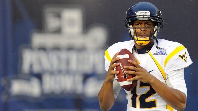 West Virginia Mountaineers quarterback Geno Smith warms up prior the 2012 New Era Pinstripe Bowl against the Syracuse Orange at Yankee Stadium.