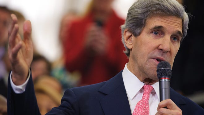 Secretary of State John Kerry speaks to employees upon arrival at the State Department on Friday in Washington, D.C.