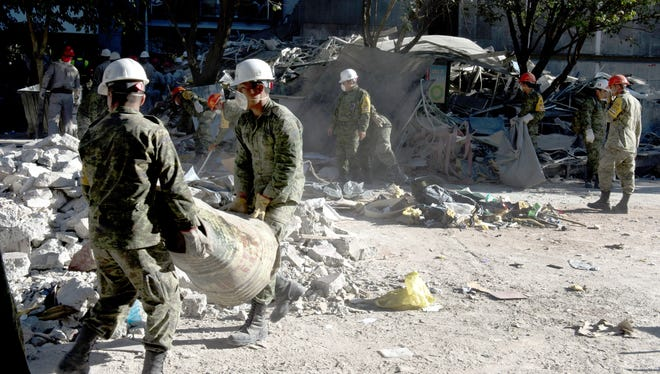 Mexican soldiers remove debris at the building of state-owned Mexican oil giant Pemex in Mexico City on Feb. 4.