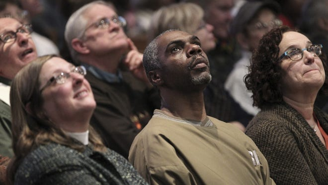 The Rev. Gayle Catinella, left; David West, center; and Donna Weinberger listen to arguments for Ohio Medicaid expansion at a meeting at Olivet Institutional Baptist Church in Cleveland. More than 1,000 people rallied at the church Jan. 24 to show their support for expanding Medicaid in Ohio.