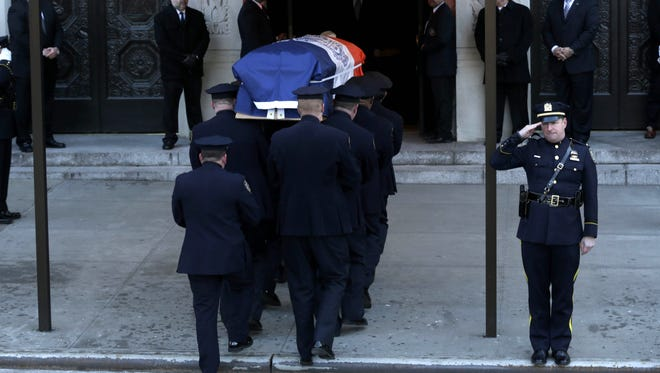 The casket containing the body of former New York City mayor Ed Koch is brought into Temple Emanu-El for his funeral.