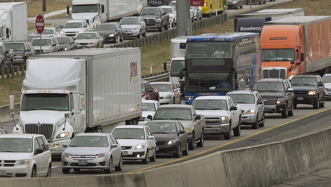 Vehicles in Austin wait on Jan. 15 after a crash on I-35. A study says 2011's congestion caused drivers to travel 5.5 billion additional hours.