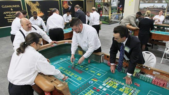 New hires train at the Table Games Service Academy at Horseshoe Casino Cincinnati,  Nov. 27, 2012.