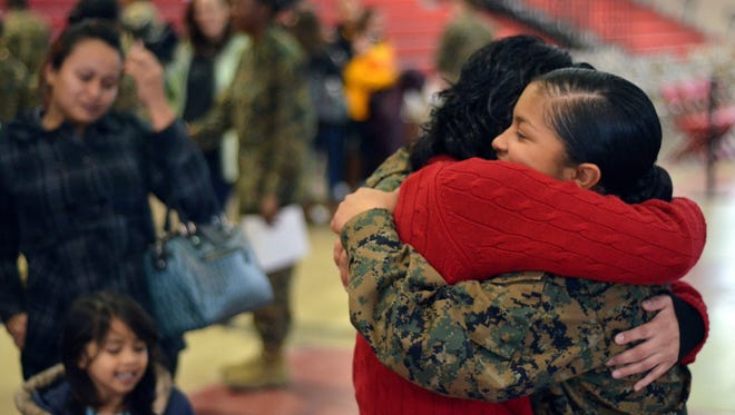 Pvt. Marleni Cruzcarranza of Sterling, Va., receives a hug from best friend Lauren Sanchez after receiving her U.S. citizenship during a naturalization ceremony Jan. 3 at Marine Corps Recruit Depot Parris Island, S.C. She was in a platoon that got out four weeks earlier than the most recent graduates.