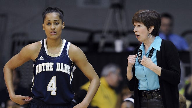 Notre Dame coach Muffet McGraw, right, talks to Skylar Diggins during a break in play in the first half against Villanova.