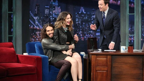 Russell Brand offers Katharine McPhee a seat on Monday's 'Late Night with Jimmy Fallon' show.