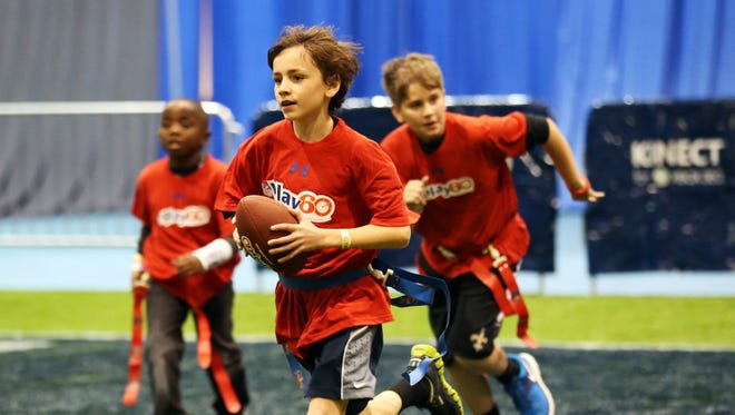 At the NFL Play 60 Youth Football clinic during Super Bowl week, children had the opportunity to learn flag football, sportsmanship and team work from current and former NFL players and USA Football staff.