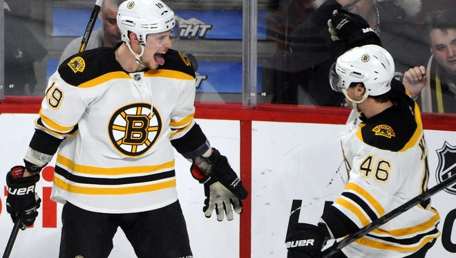 Boston Bruins forward Tyler Seguin (19) celebrates his goal against the Montreal Canadiens with teammate David Krejci (46) at the Bell Centre. The Bruins won 2-1.