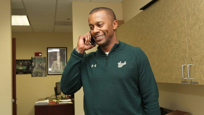 South Florida coach Willie Taggart talks with a player on the phone after he signed during national signing day at Lee Roy Selmon Athletic Building at the University of South Florida football offices on Wednesday.