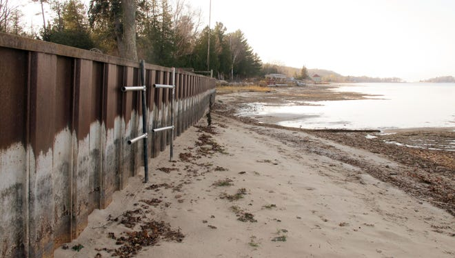 In this Nov. 2012 photo, white streaks on a steel breakwall show the normal water level on Portage Lake at Onekama, Mich., which is connected by a channel to Lake Michigan. Two of the five Great Lakes -- Michigan and Huron -- are at their lowest level on record.