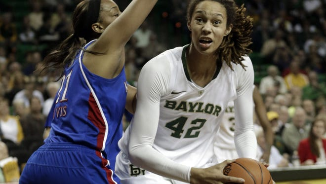 Baylor's Brittney Griner looks to shoot past Kansas' Carolyn Davis during the first half in Waco Texas.