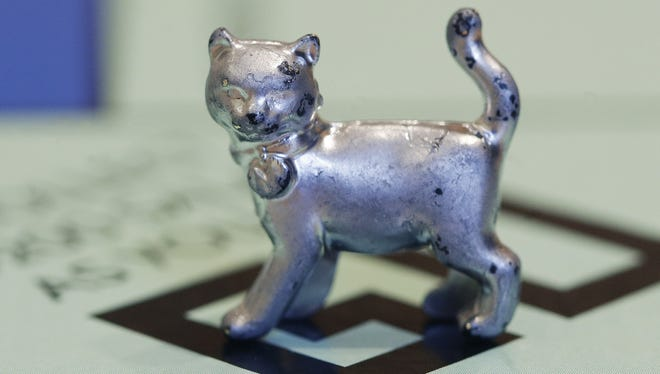 """The newest 'Monopoly' token, a cat, will be passing """"Go"""" on boards around the world soon."""