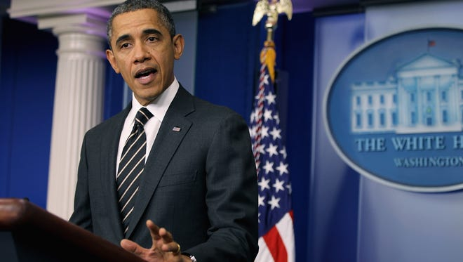 President Obama at a news conference Tuesday urges Congress to pass a fast fix to avoid automatic spending cuts March 1.