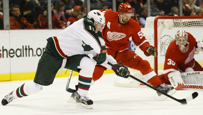 Minnesota winger Dany Heatley, left, has been moved off the Wild's top line.