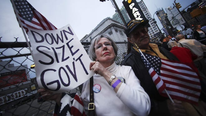 A couple participate in the Tax Day tea protest in New York on April 15, 2010.