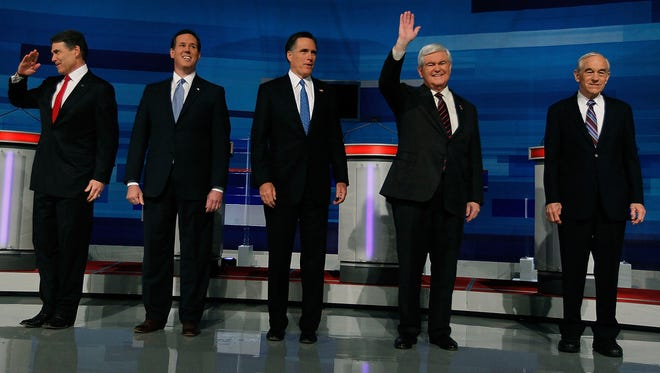 Republican presidential candidates (L-R) former U.S. Sen. Rick Santorum of Pennsylvania, former Massachusetts Gov. Mitt Romney, former U.S. House Speaker Newt Gingrich and U.S. Rep. Ron Paul (R-TX) pose for a photos before participating in a Fox News, Wall Street Journal sponsored debate at the Myrtle Beach Convention Center on January 16, 2012 in Myrtle Beach, South Carolina. Voters in South Carolina will head to the polls on January 21 to vote in the Republican primary election to pick their choice for U.S. presidential candidate.  (Photo by Joe Raedle/Getty Images) ORG XMIT: 137226885 ORIG FILE ID: 515770046